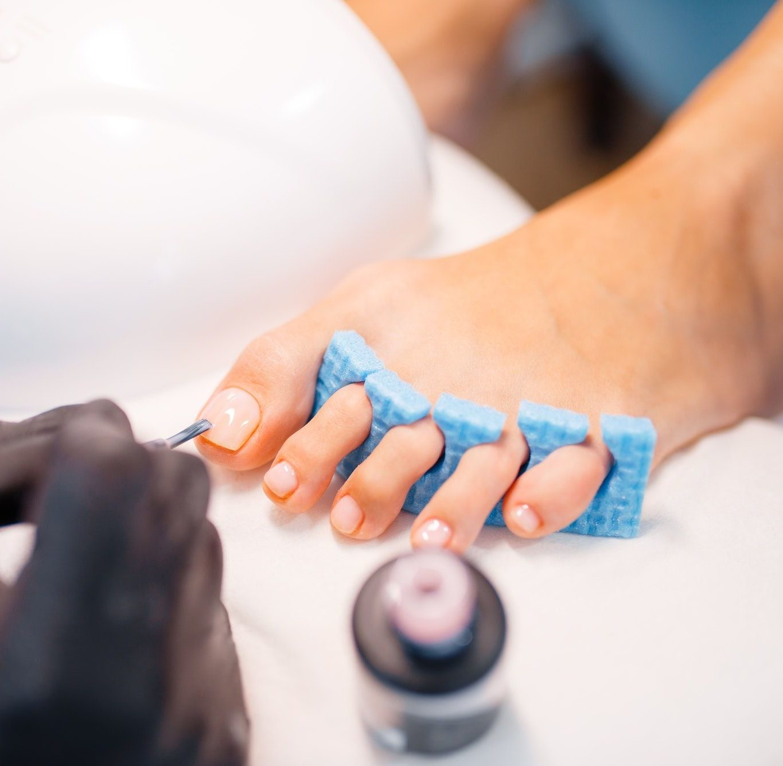 Beautician salon, pedicure, varnish application