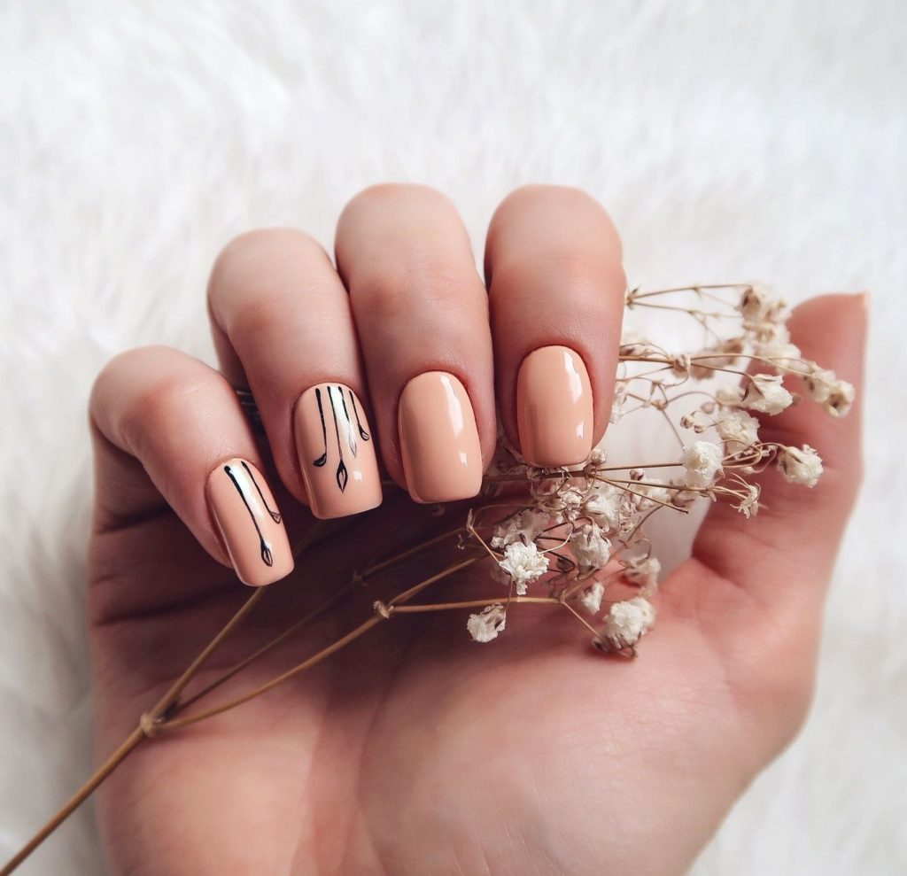 Creative manicure beige color
